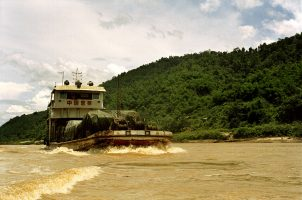 In 2001, Chinese crews, blasted and dredged a stretch of the river running from Burma and Laos to Thailand, clearing away islands, reefs and rapids that once blocked the passage of ships. Yet Chinese dams, along with engineering projects to make the river navigable by larger vessels, have begun to ravage the river's ecology.